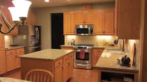 Exciting Starmark Cabinets With Under Cabinet Microwave And Under Cabinet  Lighting Plus St Cecilia Granite Countertop