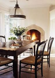 arched fireplace eye level in dining room of course with a hearth kitchen with fireplace