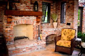 red brick fireplace distressed wood mantel outdoor fireplace angelo s lawn scape of louisiana inc