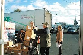 to enlarge the better living center a large food pantry in spokane is switching to a
