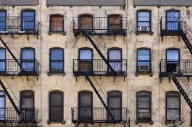 Three Floors Of Windows With Fire Escapes On The Facade Of A - New york apartments outside