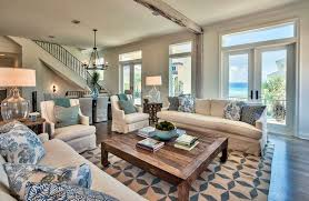 coastal themed living room with blue and white decor and furniture