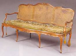 French Provincial Louis XV period walnut and caned canap For