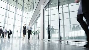 office building interior busy. Plain Office Diverse Team Of Business People Chat Together As They Walk Around Their  Light And Modern Office  In Office Building Interior Busy D