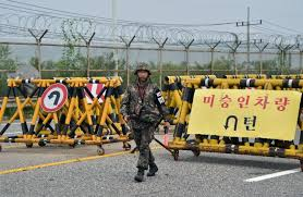 s korea defiant as north attack deadline looms a south korean ier walks by barricades on the road leading to s kaesong joint