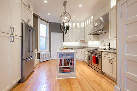 long view of remodeled washington dc kitchen shows original hot water heat radiator low windows