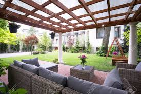 comfortable porch furniture. Designed Modern Arbour With Comfortable Garden Furniture Stock Photo - 41610902 Porch