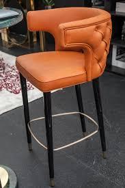 an orange bar stool