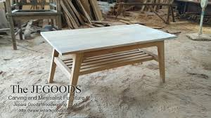 we design and produce modern mid century coffee table retro scandinavia furniture styles made of teakwood indonesia best traditional handmade