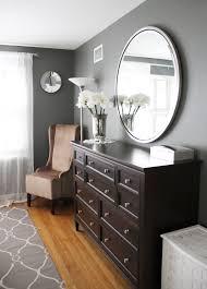 similar color palette dark wood grey walls beige chair round mirror over long dresser both ethan allen paint benjamin moore s amherst grey