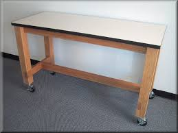 wood frame laboratory table standard laminated top shown with optional casters quote me enter dimensions at left or below to visit
