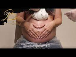 pregnancy belly cast with hands heart