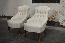pair of curvaceous vintage swedish emma slipper chairs newly upholstered in luxurious