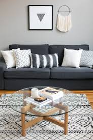 living room decor with black sofa. 5 fail-proof ways to make your home look more expensive living room decor with black sofa