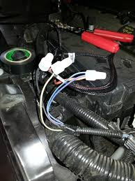 how to easy factory hid headlight install ford mustang forum in the factory headlights so just wire the ground from the retrofitsource harness to a grounded bolt this is a picture of the left side light spliced