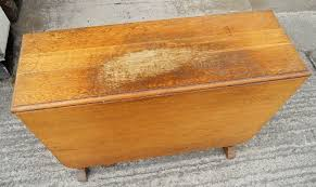 Furniture restoration — rescuing a damaged oak table with beeswax