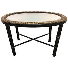 hollywood regency beveled mirror top black oval coffee table with bronze mounts for