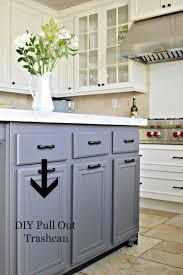 black cabinet hardware. Glittering Kitchen Island With Hidden Trash Bin Also Shiny Black Cabinet Hardware And White Ceramic Jug