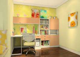 vibrant kids study room interior design with yellow wallpaper and small  swivel chair