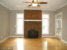 brick fireplace light wood flooring