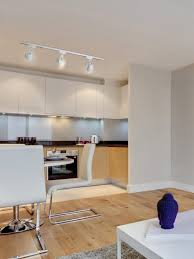 spot lighting ideas. Kitchen Spot Lighting Ideas Mounted On Textured Gypsum Ceiling Panels Above Cantilever Dining Chair Also Resin C