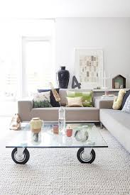 table on wheels. scandinavian living room with glass coffee table on wheels [design: gosto design \u0026 lifestyle
