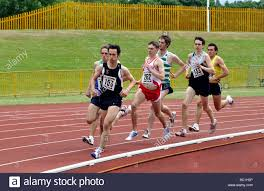 Men Running In Middle Distance Track Race Stock Photo 24621626 Alamy