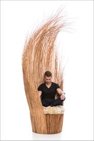 Designer Tiago Curioni, has created Savannah, a sculptural armchair made  entirely from wicker branches