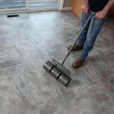 vinyl tile roller using a pound roller to bond tile flooring vinyl floor tile roller vinyl
