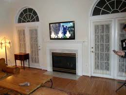 mount tv over fireplace latest with mounting above fireplace mount tv above fireplace no studs