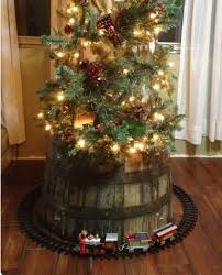 train around a christmas tree on top of a whiskey barrel
