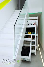Prolific White Wooden Pull Out Cabinetry Storage Under Stairs For Shoes  Racks And Appliance Storage Added Glass Banister Rails Decoration Ideas