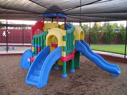 playground  combination playground structure for small children slides climbers stairs in this case playhouse
