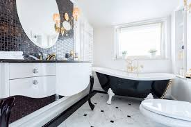 a clawfoot tub always draws the eye and the black and white shades of this one tie the look of the rest of the room together complete with a coordinating