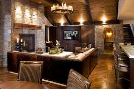 View in gallery Natural stone and reclaimed timber shape the rustic living  room [Design: John Kraemer &