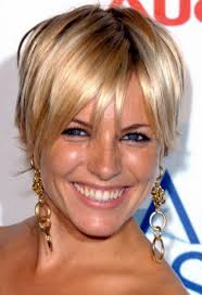 short layered hairstyles for fine hair over 50 a slightly angled bob with soft side bang
