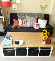 diy ikea kallax unit into a large coffee table with storage via makescoutdiy