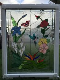 erfly hummingbird flowers insulated triple pane leaded stained glass window panel pre installed into a vinyl frame 24 x 36 in