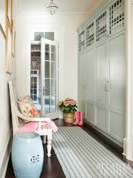 in the mudroom custom lockers painted wiith benjamin moore s beach glass everything from sports equipment to work bags