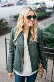 bows sequins wearing a green leather jacket a lace up blouse and