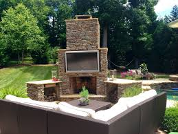 appealing backyard stone fireplace designs with outdoor fireplace plans including outdoor entertainment area with l shaped white sofa for building masonry