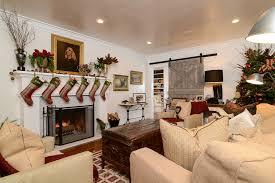 traditional living room with barn door christmas decor zillow
