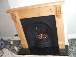 wood fireplace with cast iron insert black granite hearth and gas fire burscough