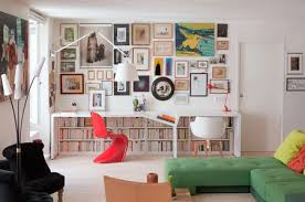 Office living room Studio Home Office With Hidden Bookcase And Gallery Wall The Spruce 27 Surprisingly Stylish Small Home Office Ideas