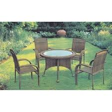 4 rattan chair and 1 round table set for hotel garden
