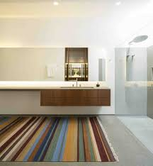 marcio kogans casa lee concrete house wooden and white bathroom with down lighting and glass bathroom down lighting