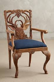 handcrafted dining chairs. anthopologies woodland inspired menagerie dining room furniture is about as dreamy could be isnt it? handcrafted chairs
