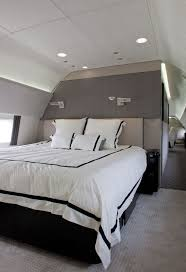 white modern master bedroom. Nice Private Jet Interior Photos With Modern Master Bed White Covered Also Pillows Bedroom O