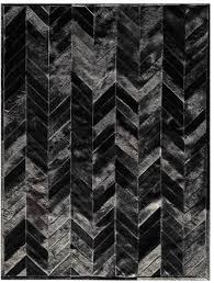 yves black cowhide rug