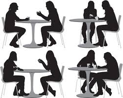 sitting people at a table